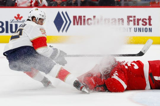 Red Wings goaltender Jimmy Howard stops a shot by Panthers center Denis Malgin during the second period of the Wings' 4-1 loss to the Panthers on Saturday, Jan. 18, 2020, at Little Caesars Arena.