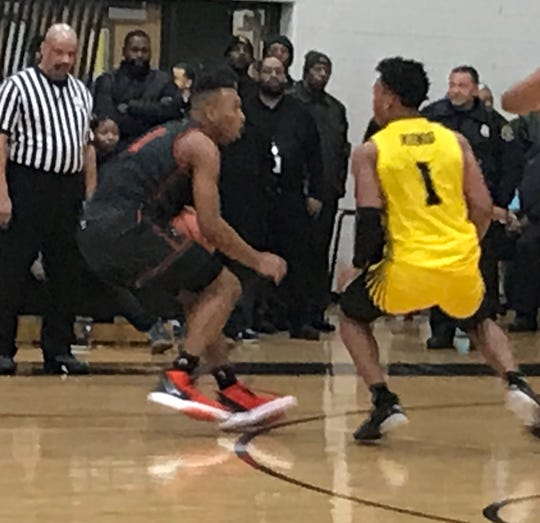 Detroit Douglass' Pierre Brooks II tries to drive against Detroit King's Omar Zeigler Jr. during King's win on Friday, Jan. 17, 2020, at King.