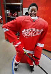 Blake Watson, 10, looks comfortable behind the pads and uniform of a Detroit Red Wings player.