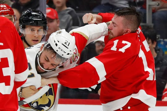 Panthers center Vincent Trocheck, left, fights Red Wings defenseman Filip Hronek during Detroit's 4-1 loss at Little Caesars Arena on Saturday.