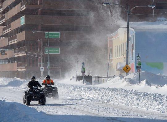 Two all-terrain vehicles cruise through downtown St. John's Newfoundland on Saturday, Jan. 18, 2020.