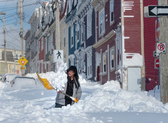 A resident digs a path from his house in St. John's Newfoundland on Saturday, Jan. 18, 2020.