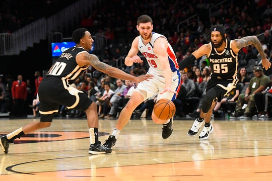 Pistons guard Sviatoslav Mykhailiuk, center, is coming off back-to-back career-high scoring nights against the Celtics and Hawks.