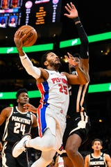 Detroit Pistons guard Derrick Rose goes up to shoot as Atlanta Hawks forward Cam Reddish defends during the second half.