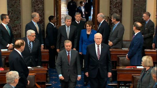 Sen. Lindsey Graham, R-S.C., left, Sen. Patrick Leahy, D-Vt., Sen. Dianne Feinstein, D-Calif., and Sen. Roy Blunt, R-Mo., escort Supreme Court Chief Justice John Roberts into the Senate chamber in the Senate at the U.S. Capitol in Washington, Thursday, Jan. 16, 2020.