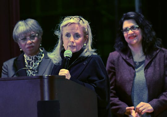 U.S. Rep. Debbie Dingell, center, talks Sunday about her late husband, Rep. John Dingell, the late Rep. John Conyers and Rep. John Lewis with Reps. Brenda Lawrence, left, and Rashida Tlaib looking on during the eleventh annual MLK Legacy Awards in Detroit