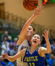 Memorial's Savannah Warren (10) and Castle's Carly Harpenau (11) battle for a rebound as the Memorial Tigers play the Castle Knights in the girls Southern Indiana Athletic Conference tournament championship Saturday evening at North High, January 18, 2020.