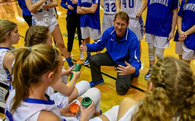 Memorial Coach Lee Auker talks to his team during a timeout as the Memorial Tigers play the Castle Knights in the girls Southern Indiana Athletic Conference tournament championship Saturday evening at North High, January 18, 2020.