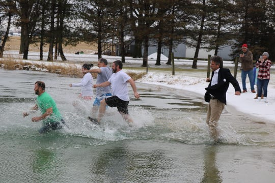 Sandusky County Commissioner Scott Miller stood out among the seven as the only one who made the polar plunge dressed in complete business attire.