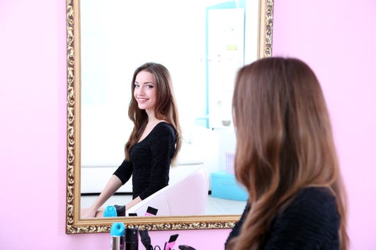 Researchers say that reducing the amount of times you look at yourself in the mirror could improve self image.