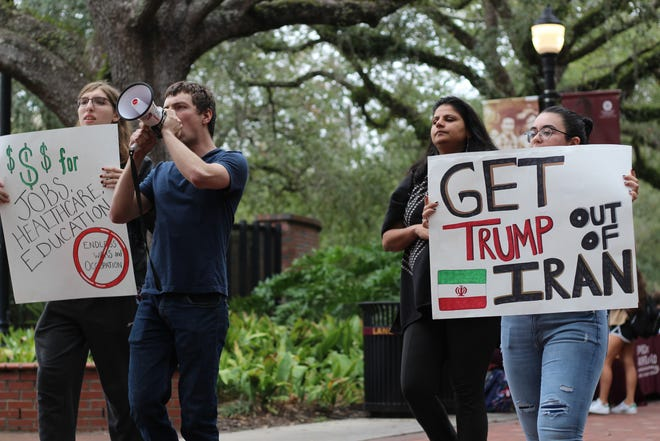Members of  Students for Democratic Society rally around FSU's Integration Statue to protest the Trump Administration's involvement with Iran.