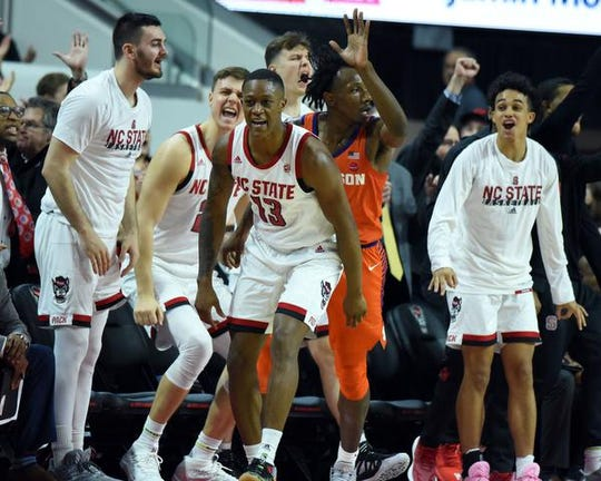 Jan 18, 2020; Raleigh, North Carolina, USA; North Carolina State Wolfpack guard C.J. Bryce (13) reacts after hitting a three-pointer during the second half against the Clemson Tigers at PNC Arena. Mandatory Credit: Rob Kinnan-USA TODAY Sports