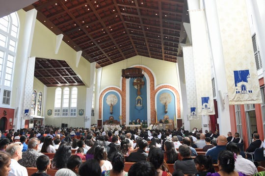 Guam's Catholic faithful gather to witness the investiture ceremony of Archbishop Michael J. Byrnes at the Dulce Nombre de Maria Cathedral-Basilica in Hagåtña, Jan. 19, 2020.