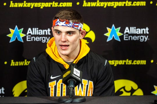 Iowa's Abe Assad met with the media after winning his Carver-Hawkeye Arena debut on Saturday, Jan. 18. The true freshman is now 18-3 this season and is ranked No. 6 nationally at 184 pounds.