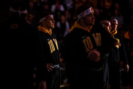 Iowa's Abe Assad, far left, waits to be introduced ahead of the top-ranked Hawkeyes' dual against Nebraska on Saturday, Jan. 18. Assad rallied to beat All-American Taylor Venz, 6-4, at 184 pounds that night.