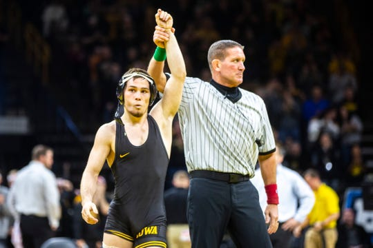 Iowa's Spencer Lee has his hand raised after scoring a technical fall during a NCAA Big Ten Conference wrestling dual against Nebraska, Saturday, Jan. 18, 2020, at Carver-Hawkeye Arena in Iowa City, Iowa.