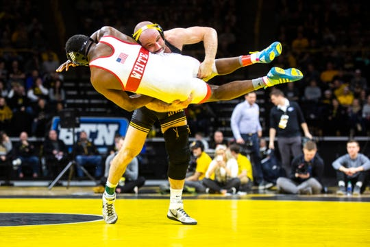Iowa's Alex Marinelli wrestles Nebraska's Isaiah White at 165 pounds during a NCAA Big Ten Conference wrestling dual, Saturday, Jan. 18, 2020, at Carver-Hawkeye Arena in Iowa City, Iowa.