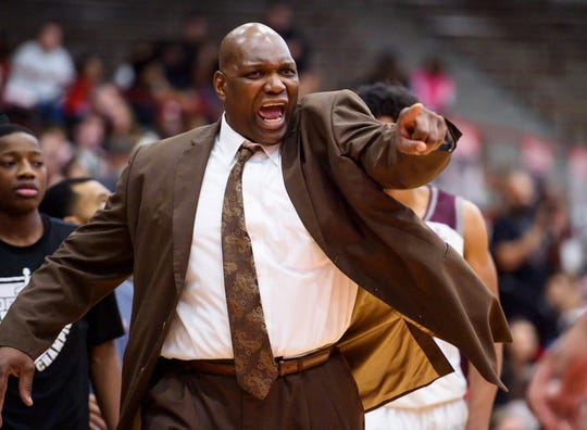 Lawrence Central High School head coach Albert Gooden reacts to the action on the court during the first half of the championship game in the 2020 Marion County Boys' Basketball Tournament against Lawrence North High School, Saturday, Jan. 18, 2020, at Southport High School.