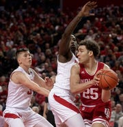 Indiana's Race Thompson (25) is defended by Nebraska forward Kevin Cross, center, and guard Thorir Thorbjarnarson during the first half of an NCAA college basketball game Saturday, Jan. 18, 2020, in Lincoln, Neb. (Francis Gardler/Lincoln Journal Star via AP)