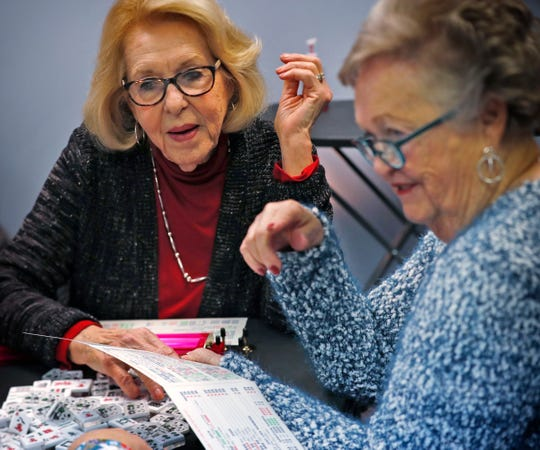 Marilyn Crawford, left, and Rose Donohue check possible hands as they play at the Fishers Mah Jongg Center, Wednesday, Jan. 15, 2020.