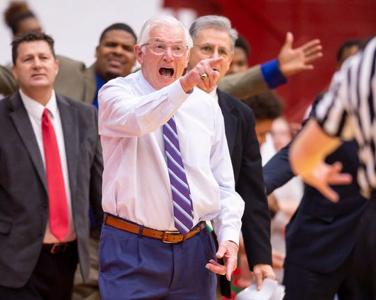 Lawrence North High School head coach Jack Keefer reacts to the action on the court during the first half of the championship game in the 2020 Marion County Boys' Basketball Tournament against Lawrence Central High School, Saturday, Jan. 18, 2020, at Southport High School.