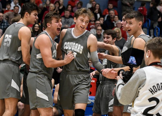 Greenwood Christian Cougars guard Derek Petersen (21) is announced in the lineup before tip-off against the Center Grove Trojans in the Johnson County tournament final hosted by Franklin Community High School on Saturday, Jan. 18, 2020. The Greenwood Christian Cougars defeated the Center Grove Trojans 51-40.
