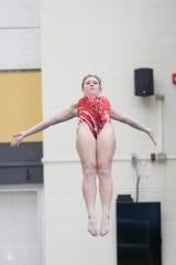 Rensselaer's Darian McAdow competes in the girls one meter dive during the Hoosier Conference Championships, Saturday, Jan. 18, 2020 in West Lafayette.