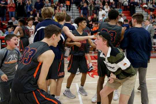 Harrison's Peyton Welch (33) and Garett Wooley celebrate after Harrison defeated West Lafayette in double overtime, 56-52, Saturday, Jan. 18, 2020 in West Lafayette.