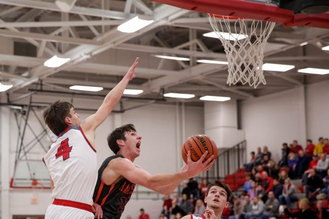 Harrison's Jordan Walters (12) goes up for a layup around West Lafayette forward Will Lasater (4) during the third quarter of an IHSAA boys basketball game, Saturday, Jan. 18, 2020 in West Lafayette.