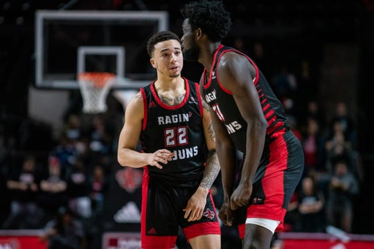 UL freshman guard Calvin Temple (left, 22) has entered the NCAA transfer portal, but big man Dou Gueye (right) is expected to return for the Ragin' Cajuns for 2020-21.