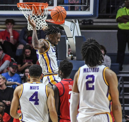 LSU forward Emmitt Williams (5) dunks against Mississippi during an NCAA college basketball game in Oxford, Miss., Saturday, Jan. 18, 2020. (Bruce Newman/The Oxford Eagle via AP)