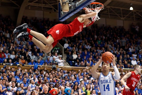 Samuell Williamson throws down a dunk at Duke.