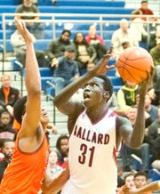 Ballard forward Maker Bar prepares to shoot in the champlonshp game of the Boys LIT tournament as Fern Creek center Darrius Washington, left, defends the basket. Bar was named the tournament's most valuable player.