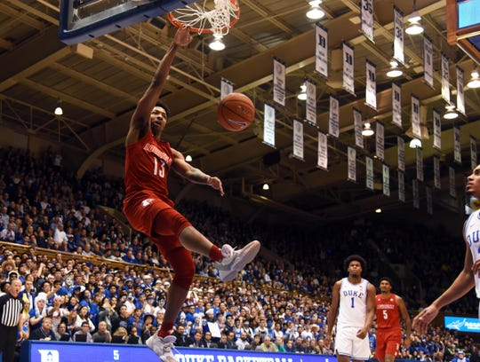 David Johnson throws down a dunk at Duke.