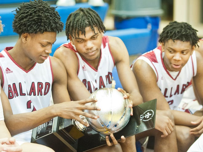 Ballard guard Kennedy Hayden, left, Ballard forward Rashad Bishop, center and Ballard forward Derrick Tilford, right, check out their team's championship trophy in the Boys LIT tournament after defeating Fern Creek, 57-51.