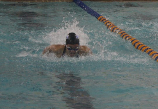 Ontario's Amy Evans wins the 100 butterfly to help the Warriors win the MOAC girls title for the third straight year