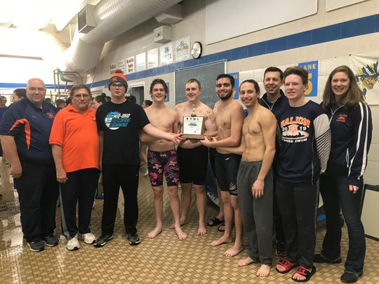 Head coach Ted Temple, second from left, and his Galion boys celebrated their fifth MOAC swim title in six years