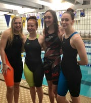 Shelby's 400 free relay team of, from left, Kassie Stine, Rylie White, Reyna Hoffman and Riley Lewis set an MOAC record on Saturday
