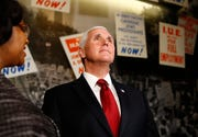 Director of Interpretation, Collections and Education Noelle Trent leads Vice President Mike Pence on a tour of the National Civil Rights Museum in Memphis on Sunday.