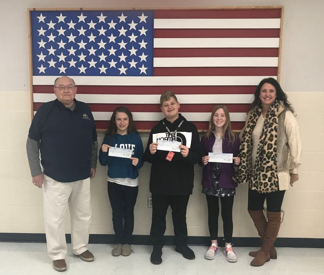 """The Pinkston Middle School sixth-grade winners of the 2019-2020 Elks Americanism Essay Contest recently were honored at an awards assembly. Over 270 essays were entered with the theme """"What Does Freedom of Speech Mean to Me?"""" The top three winners received a check for $100 each from the Mountain Home Elks Lodge and their essays will be forwarded for state and national judging. Shown are (from left) Stuart Friend, Elks president; Symphony Fox, Konnor Brewer, and Bailey Byrd, essay winners; and Vonya Schaufler, sixth grade science teacher and Elks Americanism chair."""