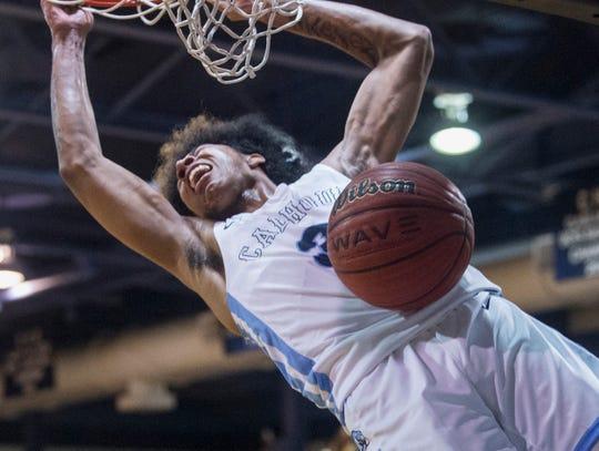 Calhoun's JD Davison (3) dunks the ball at Calhoun High School in Letohatchee, Ala., on Saturday, Jan. 18, 2020. Calhoun defeated Central-Hayneville 93-83.