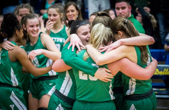 Yorktown celebrates defeating Wapahani during their county championship game at Delta High School Saturday, Jan. 18, 2020.