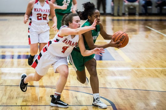 Yorktown's Amari Wright looks to pass against Wapahani during their county championship game at Delta High School Saturday, Jan. 18, 2020.