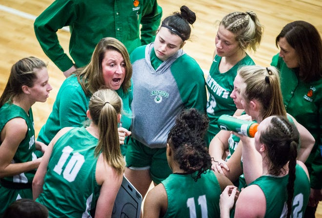 FILE -- Yorktown's girls basketball team meets up during its county championship game against Wapahani at Delta High School Saturday, Jan. 18, 2020.
