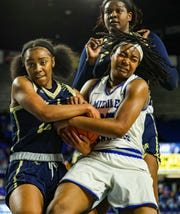 MTSU's Charity Savage (35) wrestle the ball away from an FIU player. Savage finished with 10 boards against the Panthers on January 18, 2019.