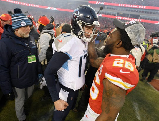 Tennessee Titans quarterback Ryan Tannehill (17) chats with Kansas City Chiefs running back Damien Williams (26) after the Titans' 35-24 loss in the AFC Championship game at Arrowhead Stadium Sunday, Jan. 19, 2020 in Kansas City, Mo.