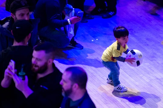 A young fan plays with a soccer ball during the Nashville SC 2020 Kit Reveal Party at Wildhorse Saloon on Jan.18 in Nashville.