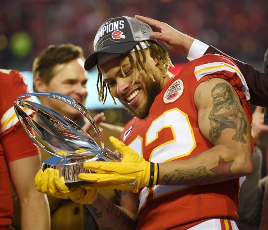Kansas City Chiefs strong safety Tyrann Mathieu (32) holds the Lamar Hunt Trophy after the team's 35-24 win over the Tennessee Titans in the AFC Championship game at Arrowhead Stadium Sunday, Jan. 19, 2020 in Kansas City, Mo.