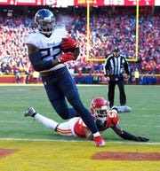 Tennessee Titans running back Derrick Henry (22) goes in for a touchdown against the Kansas City Chiefs during the first quarter of the AFC Championship game at Arrowhead Stadium Sunday, Jan. 19, 2020 in Kansas City, Mo.