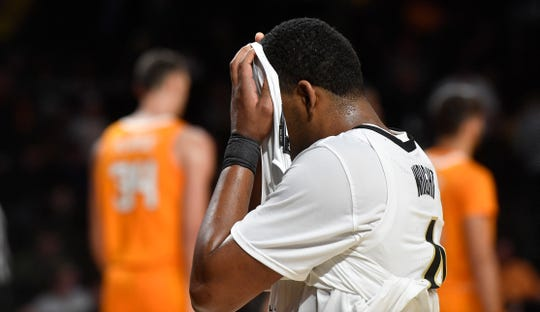 Vanderbilt guard Jordan Wright (4) covers his face as the buzzer sounds and Vanderbilt had been beaten by Tennessee 66-45 in Memorial Gym in Nashville, Tenn. Saturday, Jan. 18, 2020.
